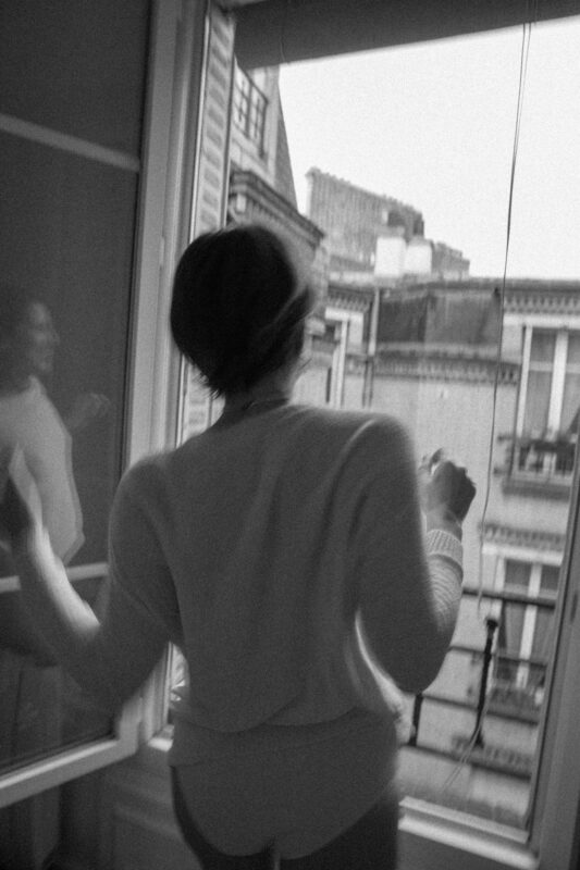Alex in black and white dancing and window reflection jeppirachi collection